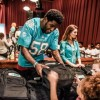 Miami Dolphins Host Back to School Backpack Event at Dave & Buster's