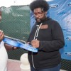 SOUTH FLORIDA FORD CONTEST WINNER RECEIVES SUNFEST GUITAR SIGNED BY PERFORMERS