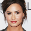 Demi Lovato wore 2ct black diamond Harry Kotlar studs to Glamour Women Of The Year 2016