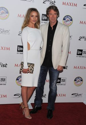 Director Michael Bay and actress Rosie Huntington-Whiteley attend ...