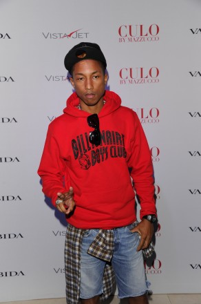 "Pharrell Williams attends Andy Valmorbida, Jimmy Iovine, And Sean ""Diddy"" Combs, Celebrate Culo By Mazzucco, Presented By VistaJet at Mr. Chow's on December 2, 2011 in Miami, Florida.  (Photo by Andrew H. Walker/Getty Images for Andy Valmorbida)"