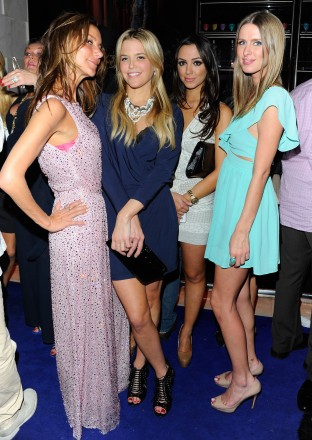 """Nicky Hilton (R) attends Andy Valmorbida, Jimmy Iovine, And Sean """"Diddy"""" Combs, Celebrate Culo By Mazzucco, Presented By VistaJet at Mr. Chow's on December 2, 2011 in Miami, Florida.  (Photo by Andrew H. Walker/Getty Images for Andy Valmorbida)"""