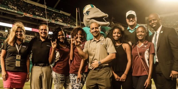 (from L-R) AutoNation Manager of Corporate Affairs & Communications Paula Levenson, AutoNation Miami Market President Benny Dominguez, students Toni-Ann, Selena Gayle, Norland High School Vice Principal Jorge Bulnes, student Tanisha, WFOR's Kim Bokamper, student Tykerria, Miami Dolphins Senior Vice President of Communications & Community Affairs Jason Jenkins.