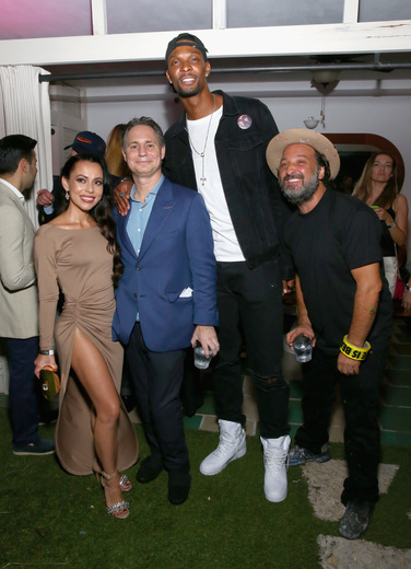 (L-R) Adrienne Bosh, Jason Binn, NBA player Chris Bosh, and artist Mr. Brainwash attend the DuJour Media, Gilt & JetSmarter party to kick off Art Basel at The Confidante on November 30, 2016 in Miami Beach, Florida. (Photo by Astrid Stawiarz/Getty Images for DuJour)