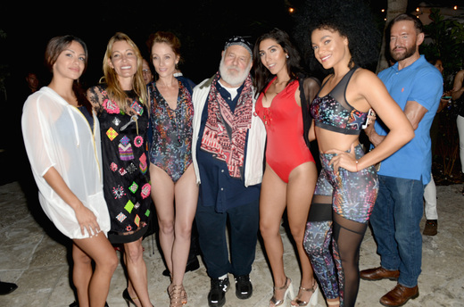 Bruce Waber (c) posses with models of Hollie Watman at the DuJour Media, Gilt & JetSmarter party to kick off Art Basel at The Confidante on November 30, 2016 in Miami Beach, Florida. (Photo by Gustavo Caballero/Getty Images for DuJour)