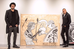 Left to Right: Harif Guzman and Actor Hill Harper of CSI NY. Sneak peek preview of Harper and Guzman, EAST, Miami's very first artist in residency, making final touches to a collection created on prop