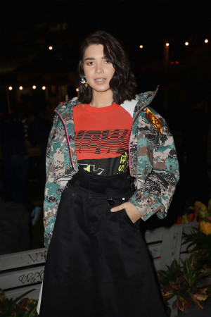 Vanessa Zambito: Field Jacket with Fluo Accents Women's Cropped Jacket, Multicolored Jacquard Short Sleeve Knit, Black Cotton Wide Leg Pleated Pant all from the Diesel Spring 2019 Collection