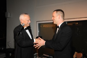FGO President and CEO Bob Heuer honors former FGO Young Artist Tom Corbeil at the After Opera Party for returning to the company to sing one of the leading roles (Leperello) in Don Giovanni.