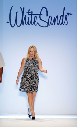 Designer Leah Madden walks the runway at the White Sands Australia show during Mercedes-Benz Fashion Week Swim at The Raleigh on July 15, 2011 in Miami Beach, Florida.