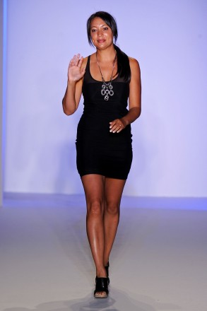 Designer Crystal Jin walks the runway at the Crystal Jin show during Mercedes-Benz Fashion Week Swim at The Raleigh on July 15, 2011 in Miami Beach, Florida. (Photo by Frazer Harrison/Getty Images for Mercedes-Benz)