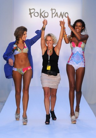 Designer Paola Robba (C) and models walk the runway at the Poko Pano show during Mercedes-Benz Fashion Week Swim at The Raleigh on July 15, 2011 in Miami Beach, Florida.