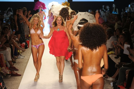 Designer Monica Wise walks the runway with models during L*SPACE BY MONICA WISE show during Mercedes-Benz Fashion Week Swim at The Raleigh on July 15, 2011 in Miami Beach, Florida.