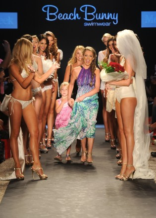 Designer Angela Chittenden, daughter Presley and model Kate Upton walk the runway at the Beach Bunny Swimwear show during Mercedes-Benz Fashion Week Swim at The Raleigh on July 15, 2011 in Miami Beach, Florida.