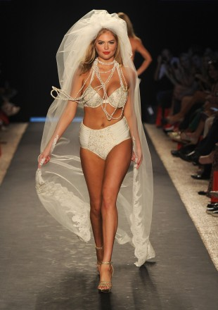 Kate Upton walks the runway at the Beach Bunny Swimwear show during Mercedes-Benz Fashion Week Swim at The Raleigh on July 15, 2011 in Miami Beach, Florida. (Photo by Frazer Harrison/Getty Images for Mercedes-Benz)