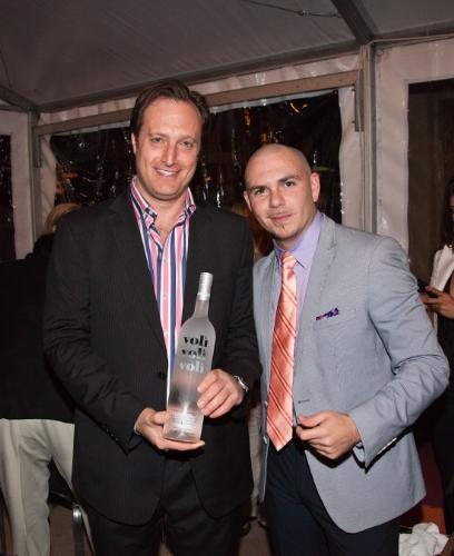 Pitbull, a major equity owner of Voli Light Vodkas, with Adam Kamenstein, CEO of Voli, at an exclusive party for spirits and restaurant industry influencers hosted by Voli Light Vodkas and importer Palm Bay International during 29th Annual Food and Wine Classic in Aspen. (Palm Bay International)