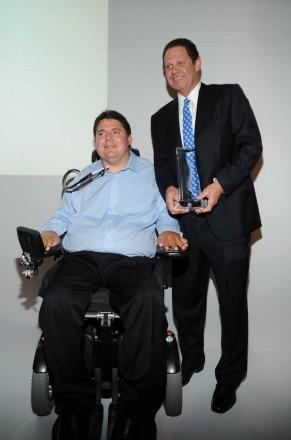 Marc Buoniconti, and Warren Zinn, owner of Warren Henry Auto Group