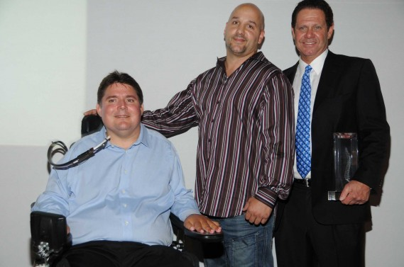 Marc Buoniconti, Nicholas Studds winner of the Range Rover Sport in auction, and Warren Zinn, owner of Warren Henry Auto Group