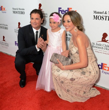 Carlos Vives and wife next to St. Jude patient Izarah at Miami Gala