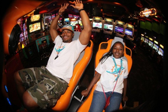 Cameron Wake with student at team service project Dave and Busters in Hollywood