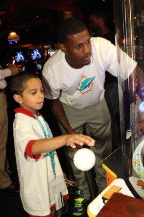 Mike Wallace with student at team service project Dave and Busters in Hollywood