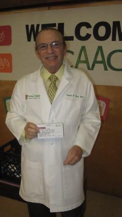 Dr. Pacin after drawing Raffle winner