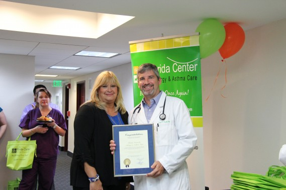 Maria Machado, Miami-Dade County Mayor's aide, and Dr. Frank J. Martell with the proclamation