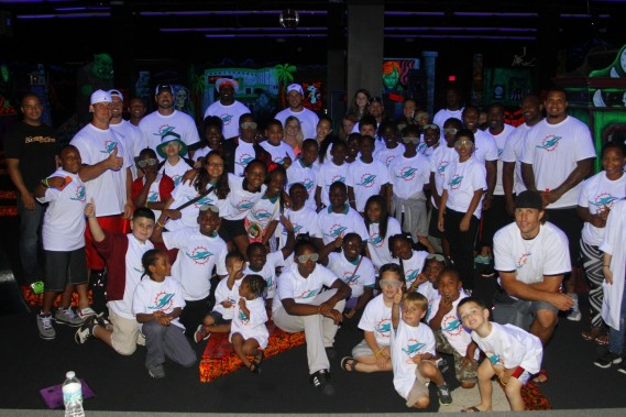 Miami Dolphins players and MDWO members with students from Henry S. Reeves Elementary at Monster Mini Golf in Miramar