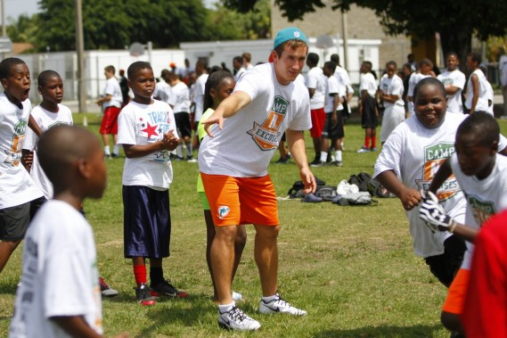 Miami Dolphins rookie Caleb Sturgis with students at Camp No Excuses football clinic