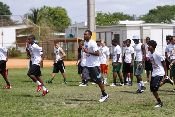 Miami Dolphins rookie Will Davis with students at Camp No Excuses football clinic