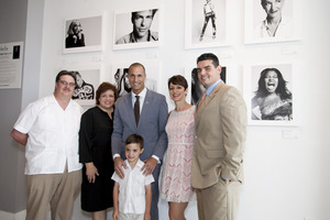 Pictured left to right; Felipe and Maria Barreda with son, Victor Barreda (front), St. Jude patient; Nigel Barker, Photographer and Host of The Face on Oxygen Network; Belkys Nerey, WSVN-Channel 7 Anchorwoman; and Chris Molho, General Manager, Village of Merrick Park pose for a photo in front of Barker's new photo exhibit at 'In the Now @ Village of Merrick Park.'