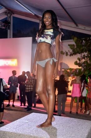 MIAMI BEACH, FL - JULY 18: A model poses at the Roxy Presentation during Mercedes-Benz Fashion Week Swim 2014 at the Raleigh Hotel on July 18, 2013 in Miami Beach, Florida. (Photo by Frazer Harrison/Getty Images for Mercedes-Benz Fashion Week Swim 2014)