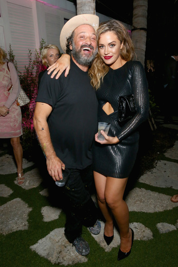Artist Mr. Brainwash and Erin Mullin attend the DuJour Media, Gilt & JetSmarter party to kick off Art Basel at The Confidante on November 30, 2016 in Miami Beach, Florida. (Photo by Astrid Stawiarz/Getty Images for DuJour)