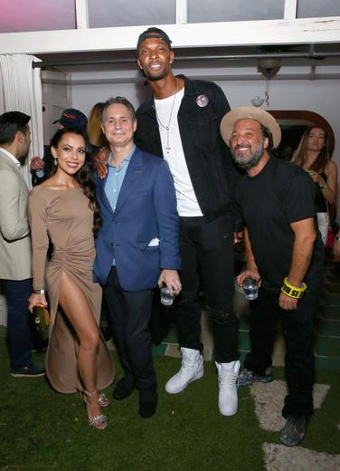 (L-R) Adrienne Bosh, Jason Binn, NBA player Chris Bosh, and artist Mr. Brainwash attend the DuJour Media, Gilt & JetSmarter party to kick off Art Basel at The Confidante on November 30, 2016 in Miami Beach, Florida. (Photo by Astrid Stawiarz/Getty Images for DuJour)