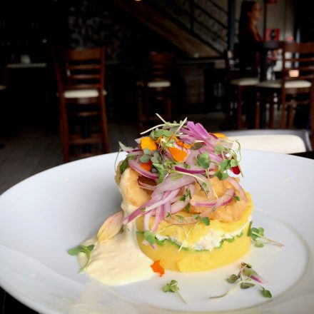 Tropical Benedict ($14), which infuses rocoto hollandaise, pineapple pico de gallo, poached eggs, pork chicharron and sweet plantain-based cake