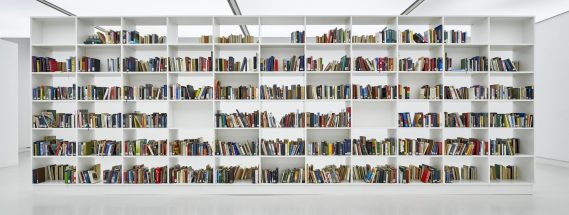 Momentary Monument – The Library 2012-2018 2200 Vintage books containing folded photos from the artist's archive Installation view NEED OR NO NEED, Kunsthalle Mainz, Mainz photo: Norbert Miguletz,