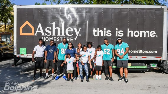 Miami Dolphins Collaborate with Ashley HomeStore to Assemble and Deliver Beds to Families in Need
