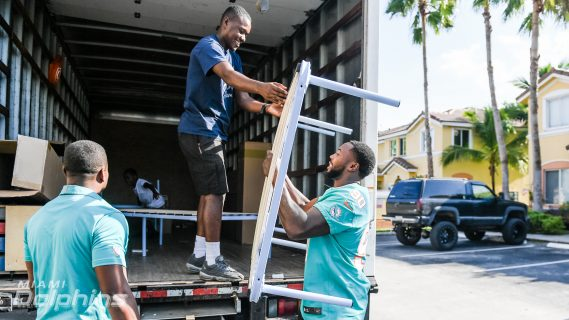Miami Dolphins DE Charles Harris Assists Ashley HomeStore in Bed Delivery