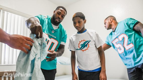 Miami Dolphins DE Charles Harris and LB Raekwon McMillan Participates in Ashley HomeStore Bed Delivery