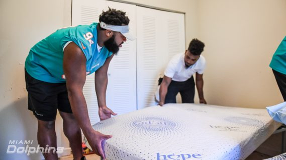 Miami Dolphins DT Christian Wilkins Assists in Ashley HomeStore Bed Delivery