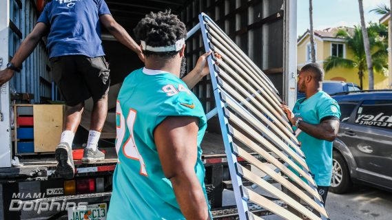 Miami Dolphins DT Christian Wilkins and LB Raekwon McMillan Assist Ashley HomeStore in Delivering Beds