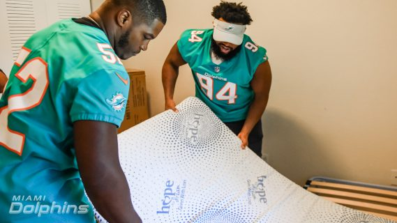 Miami Dolphins LB Raekwon McMillan and DT Christian Wilkins In Collaboration with Ashley HomeStore Assemble Beds