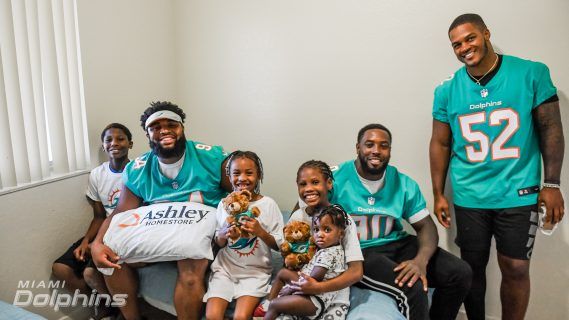 Miami Dolphins Players in Collaboration with Ashley HomeStore Deliver Beds to Families in Need