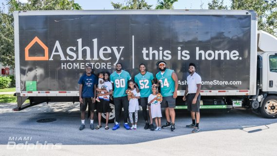 Miami Dolphins Visit Family In Need to Deliver Beds in Collaboration with Ashley HomeStore