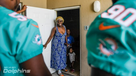 Miami Dolphins and Ashley HomeStore Visit Families In Need to Deliver Beds