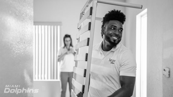 Miami Dolphins in Collaboration with Ashley HomeStore Deliver Beds to Families in Need