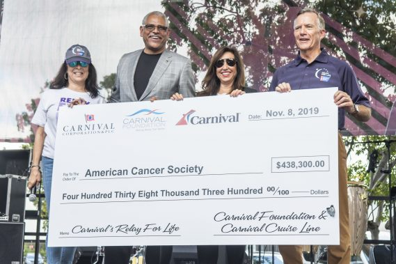 At Carnival Foundation's Relay For Life for the American Cancer Society, Linda Coll (left), executive director of Carnival Foundation; Arnold Donald, president and CEO of Carnival Corp.; and Christine Duffy, president of Carnival Cruise Line; presented a check for $438,300 raised to date to Gary Reedy (right), CEO of American Cancer Society. The six-hour event brought that figure to more than $500,000, making Carnival's total donation over $1 million.  CREDIT: Carnival Foundation