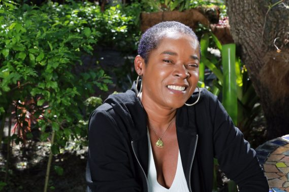 Sharon Marley wears the PIC LOVE Small Necklace.