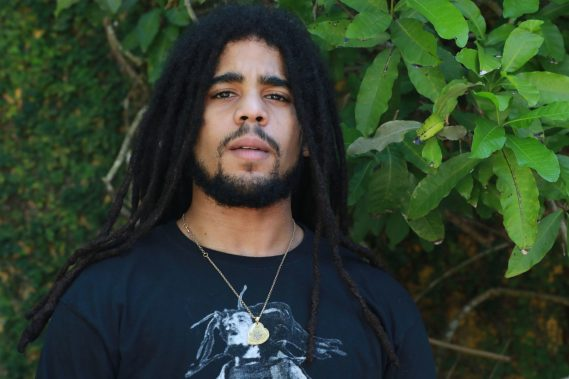 Skip Marley wears the PIC LOVE Large Necklace and Black Bracelet.