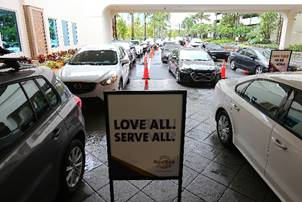Employees line up in their cars to pick up grocery store gift cards at Seminole Hard Rock Hotel & Casino Hollywood in Hollywood, Fla. Gift cards are provided to employees who make less than $50,000 a year on behalf of Hard Rock International and Seminole Gaming  Photo Credit: Seminole Hard Rock Hotel & Casino Hollywood