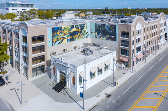 Aerial view of The Moore Building, in Miami Design District featuring billboard artwork by Adler Guerrier, in partnership with For Freedoms